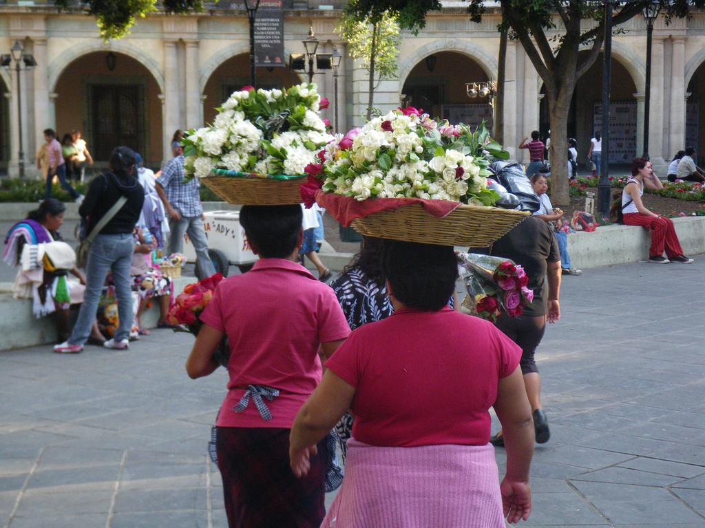 carrying flowers on their head