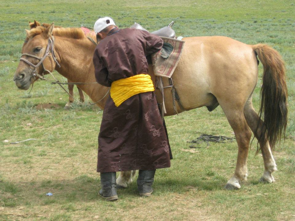 Guide and horse What They Don't Tell You About Horseback Riding in Mongolia