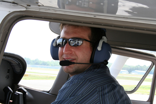 Yea, this would be an inexpensive way to fly, but really would you trust him as your pilot?